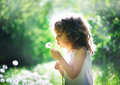 Summer joy child has with dandelion Royalty Free Stock Images
