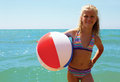Summer joy - young girl enjoying summer. Girl with ball. Royalty Free Stock Photo