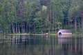 Summer lake and boat shelter Royalty Free Stock Photo
