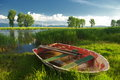 Summer lake great landscape with wonderful reflections clouds and a boat in front Royalty Free Stock Image