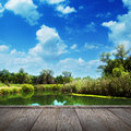 Summer landscape river and blue sky with wood pier Royalty Free Stock Photo