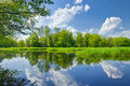 Summer landscape river clouds blue sky green trees pond Royalty Free Stock Photo