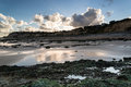 Summer landscape with rocks on beach during late evening and low beautiful Royalty Free Stock Photography