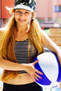 Summer leisure - active happy woman holding a ball Royalty Free Stock Photography