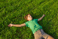 Summer leisure boy relaxing on green grass Royalty Free Stock Image