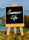 Summer life board on the beach. Royalty Free Stock Photo