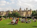 Summer at london tower londoners enjoying time in trinity sqare gardens close to Royalty Free Stock Photo