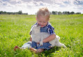 Summer loving boy and puppy Royalty Free Stock Photo