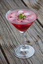Summer martini drink with ice and mint on wooden Stock Image