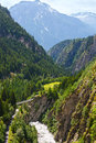 Summer mountain canyon alps switzerland landscape with bridge across ravine Stock Photo