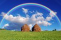 Summer mountain village landscape rainbow over haystacks Stock Photography
