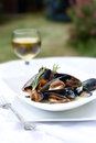 Summer mussels iii cooked in white wine and garlic sauce with a rosemary herb garnish copy space Royalty Free Stock Images