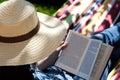 Summer novel a woman reading a on a hammock Stock Image
