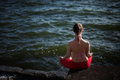 Summer outdoor yoga session by a lake meditation in beautiful place beautiful woman meditating Stock Photos