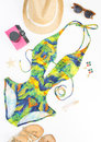Summer outfit, beach outfit, summer stuff. Exotic pattern swimsuit, retro sunglasses, gold sandals, pink retro camera Royalty Free Stock Photo