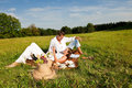 Summer picnic - Young couple relaxing in nature Stock Photos