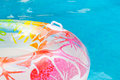 Summer pool dream multicolored swim ring floating in a blue swimming dreaming on days Stock Images
