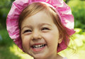 Summer portrait of adorable little baby girl laugh laughing in the park Stock Photo