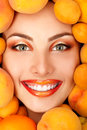Summer portrait of young healty smiling attractive woman with ri ripe big fresh peaches and apricots Royalty Free Stock Photo