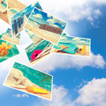 Summer postcards floating against a blue cloudy sky Stock Image