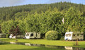 Summer rain on caravans a camp site in heavy a sunny day Stock Image