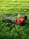 Summer Reading on the Lawn Royalty Free Stock Images