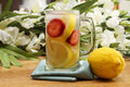 Summer refreshment lemonade glass of refreshing with strawberries and flowers lemon included in image Stock Photos