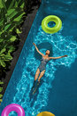 Summer Relax. Woman Floating, Swimming Pool Water. Summertime Holiday Royalty Free Stock Photo