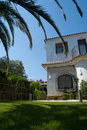 Summer residence in spain with palm trees Royalty Free Stock Photos