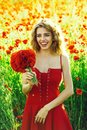 Summer rest. Fashionable woman posing. pretty woman or happy girl in field of poppy seed Royalty Free Stock Photo