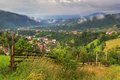 Summer rural landscape in the carpathian mountains above village moeciu bran romania Royalty Free Stock Photo