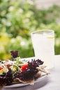 Summer salad fresh red leaf lettuce on pita bread with lemonade Stock Image