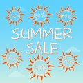 Summer sale with different percentages in suns text and signs on blue label clouds business concept Royalty Free Stock Image