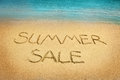 Summer sale letters on sand Royalty Free Stock Photo