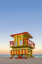 Summer scene miami beach florida colorful lifeguard house typical art deco architecture sunset ocean sky background Royalty Free Stock Photo