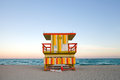 Summer scene miami beach florida colorful lifeguard house typical art deco architecture sunset ocean sky background Stock Image
