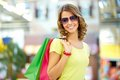 Summer shopper portrait of a shopping young woman wearing cool sunglasses Royalty Free Stock Image