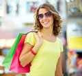 Summer shopper portrait of a shopping young woman wearing cool sunglasses Royalty Free Stock Photography