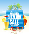 Summer sizzling sale with blue shopping bag on a beach  backdrop with palms Royalty Free Stock Photo