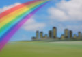 Summer skyline with rainbow Royalty Free Stock Image