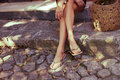 Summer slippers woman legs in flat outdoor day shot in city Royalty Free Stock Photography
