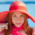 Summer smile an image of a young woman in a hat and scarf with a blue pool in the background Royalty Free Stock Photography