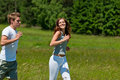 Summer - Smiling couple jogging in meadow Royalty Free Stock Photos