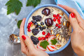 Summer smoothie bowl with berries, coconut and chia seeds Royalty Free Stock Photo