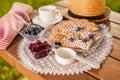 Summer snacks on wooden table in the garden Stock Photos
