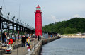 Summer at the south haven mi lighthouse people enjoy sunshine and warm weather in michigan usa to fish walk relax and enjoy this Stock Photos