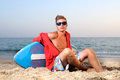Summer sport handsome teen posing in the beach with skimming board Stock Images