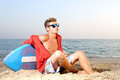 Summer sport handsome teen posing in the beach with skimming board Royalty Free Stock Photo