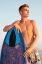 Summer sport handsome teen posing in the beach with skimming board Stock Photography