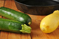 Summer squash and zucchini near a cast iron skillet Stock Photography